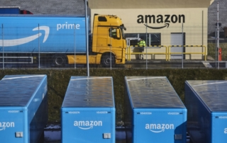 "A truck pulling an Amazon Prime branded cargo container waits beside the entrance gate at Amazon.com Inc.'s new fulfillment center in Kolbaskowo, Poland, on Friday, Feb. 28, 2018. Both academic and commercial roboticists have been putting a lot of energy into solving what's sometimes referred to as the ""picking"" challenge, and Amazon is trying to direct that energy towards its specific needs. Photographer: Bartek Sadowski/Bloomberg"